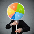 Businessman holding a pie chart — Stock Photo #53429169
