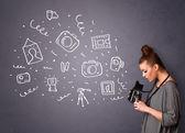 Photographer girl shooting photography icons — Stock Photo