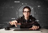 Young hacker in futuristic enviroment hacking personal informati — Stock Photo