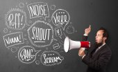 Guy in suit yelling into megaphone and hand drawn speech bubbles — Stock Photo