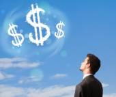 Businesman wijzen bij euroteken wolken op blauwe hemel — Stockfoto