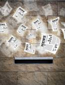 Post box with daily newspapers flying — Stock Photo