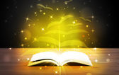 Open book with golden glow flying paper pages — Stock Photo