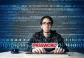 Young geek hacker stealing password  — Stock Photo