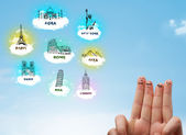 Cheerful finger smileys with sightseeing landmarks icons — Stock Photo