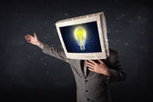 Business man with a pc monitor head and idea light bulb in the d — Stock Photo