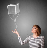 Woman holding a cube balloon — Stock Photo