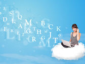 Young woman sitting in cloud with laptop — Stok fotoğraf