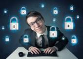 Young hacker with virtual lock symbols and icons — Stock Photo