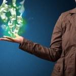 Светящийся деньги в руке женщины — Стоковое фото #56026519
