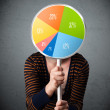 Young woman holding a pie chart — Stock Photo #56026629