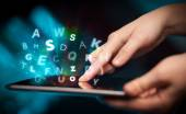 Finger pointing on tablet pc, letters concept — Stock Photo