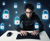 Jeune hacker avec serrure virtuel symboles et des icônes — Photo