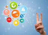Cheerful finger smileys with colorful holiday travel bubble icon — Stock Photo