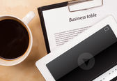 Tablet pc showing media player on screen with a cup of coffee on — Stock Photo
