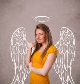 Cute girl with angel illustrated wings — Stock Photo