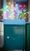 Colorful icons and symbols bursting out of a mailbox — Stock Photo