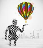 Man in full body suit holding balloon — Stock Photo