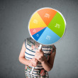 Young woman holding a pie chart — Stock Photo #57783819