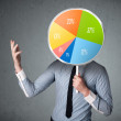 Businessman holding a pie chart — Stock Photo #58324317