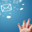 Happy smiley fingers looking at mail icons made out of clouds — Stock Photo #58324657
