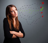 Young woman choosing between right and wrong signs — Stock Photo