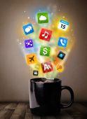 Coffee mug with colorful media icons — Stock Photo