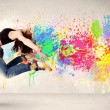 Happy teenager jumping with colorful ink splatter on urban backg — Stock Photo #58520267