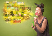 Cute girl blowing colourful glowing memory picture concept — Zdjęcie stockowe