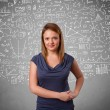 Young pretty lady with hand drawn calculations and icons — Stock Photo #58841353