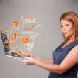 Beautiful lady holding notebook with graphs and statistics — Stock Photo #58842587