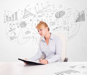 Business woman at desk with hand drawn charts  — Stock Photo