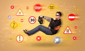 Young driver with road signs around him  — Stock Photo