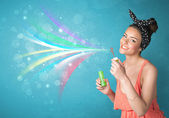 Beautiful girl blowing abstract colorful bubbles and lines — Stock Photo