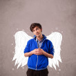 Cute boy with angel illustrated wings — Stock Photo #59334401