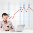 Businessman calculating stock market with rising graph in the ba — Stock Photo #59336169
