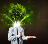 Man with green tree head concept — Stock Photo