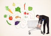 Businessman with shopping cart with vegetables — Stok fotoğraf