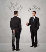 Ruthless business handshake — Stock Photo