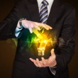 Businessman holding light bulb — Stock Photo #59511261