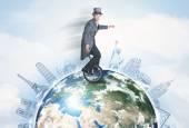 Man riding unicycle around the globe with major cities — Stock Photo