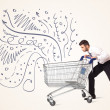 Businessman with shopping cart — Stock Photo #60033531
