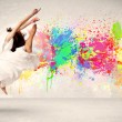 Happy teenager jumping with colorful ink splatter on urban backg — Stock Photo #60034755