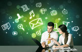 Business couple with social media symbols — Stock Photo