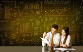 Business couple with diagram background — Stock Photo