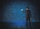 Drawing businessman with economy project background — Zdjęcie stockowe