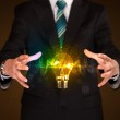 Businessman holding light bulb — Stock Photo #60046799