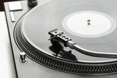 Turntable playing vinyl close up with needle on the record  — Stock Photo