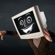 Girl with a monitor head and a cheerful cartoon face — Stock Photo #60409393