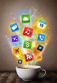 Coffee mug with colorful media icons — Stock Photo